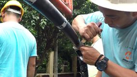 Huge electrical cable splicing and crimping. Manila, Philippines - September 23, 2016: Electrical workers splicing, stripping and crimping cap-in huge cable wire stock video