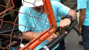 Huge electrical cable splicing and crimping. Manila, Philippines - September 23, 2016: Electrical workers splicing, stripping and crimping cap-in huge cable wire stock footage