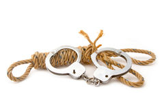 Manila rope with hand cuffs Royalty Free Stock Photography