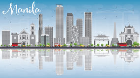 Manila Skyline with Gray Buildings, Blue Sky and Reflections. Stock Photo