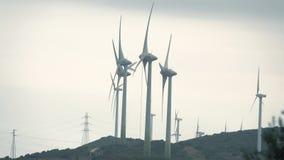 MANILVA, SPAIN - SEPTEMBER 27, 2018. Rotating Enhol wind generators on a cloudy day. MANILVA, SPAIN - SEPTEMBER 27, 2018 Rotating Enhol wind generators stock video