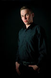 A manin a shirt on a black background Stock Photo