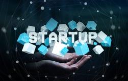 Maninnehavet som svävar 3D, framför startup presentation med kuben Arkivbild
