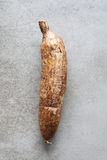 Manioc root on a kitchen board Stock Images