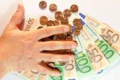 Manipulación del dinero Imagen de archivo libre de regalías