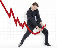Manipulating the losses or cheating the charts. Businessman trying to change the down going profits of the company Stock Photography