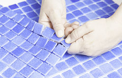 Manipulating tiles. For pools, worker workman Royalty Free Stock Photography