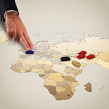 Manipulating the war. Fingers move tanks on the geographical map Royalty Free Stock Photography