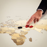 Manipulating the war. Fingers move tanks on the geographical map Royalty Free Stock Images