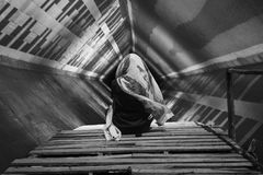 Manipulation of a woman on a pier in a tunnel. In black and white Stock Photo