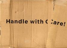Manipulez avec soin Photographie stock libre de droits