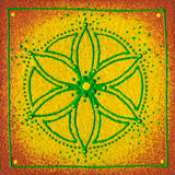 Manipura solar plexus. Hand painted mandala with yellow green and orange colours on a piece of square wood Stock Images