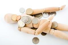 Maniquí con las monedas Fotos de archivo