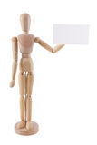 Maniquí de madera que sostiene una tarjeta con el espacio del texto Foto de archivo