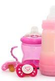 Maniquíes y botellas rosados en blanco imágenes de archivo libres de regalías