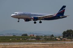 Manises, Spain - June 16, 2016: Aeroflot Airbus A320 landing at Manises airport in Valencia, Spain royalty free stock photo