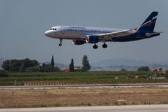 Manises, Spain - June 16, 2016: Aeroflot Airbus A320 landing at Manises airport in Valencia, Spain royalty free stock photography