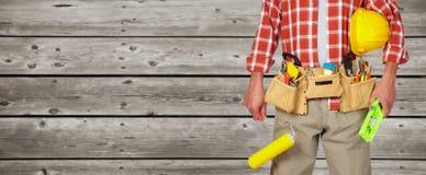 Manitas del constructor con el rodillo de pintura Foto de archivo libre de regalías