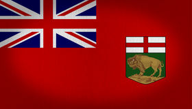 Manitoba flag. Manitoba canadian region flag with a first quarter of a british flag and a small shield in the lower right side, composed by a red cross and a Royalty Free Stock Photo