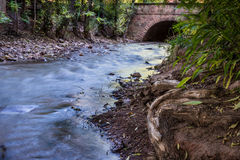 Manitou Springs Creek. Creek runs through town of Manitou Springs Colorado under the old rock bridge Stock Photo