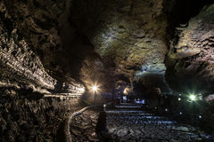 Manjanggul Lava Tube Cave on Jeju Island in South Korea. Inside the dark, lit and empty Manjanggul Lava Tube Cave on Jeju Island in South Korea. Manjanggul is royalty free stock images