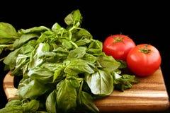 Manjericão e tomates Fotos de Stock