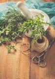 Manjerona picante da erva em uma tabela de madeira fotografia de stock royalty free