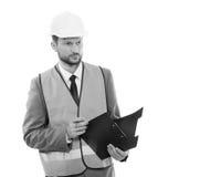 Manlig arkitekt i en västra säkerhet och en hardhathandstil på hans cli royaltyfri foto