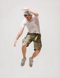 Manlig dansarebanhoppning i luften Royaltyfri Fotografi
