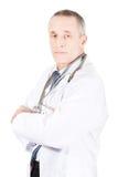 Manlig doktor med vikta armar Arkivbild