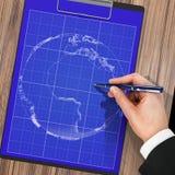 Manlig hand med pennritningen planet Royaltyfria Foton