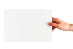 Manlig hand som rymmer arket för tomt papper royaltyfri fotografi
