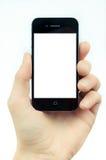 Manlig hand som rymmer en grej för smartphonehandlagdator med isolat Fotografering för Bildbyråer