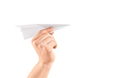 Manlig hand som rymmer ett pappers- flygplan royaltyfri foto