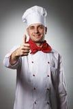 Manlig kock med tummen upp ståenden Royaltyfri Bild