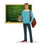 Manlig lärare med svart tavla Arkivfoto