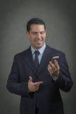 Manlig latin som gör en påringning Royaltyfri Fotografi