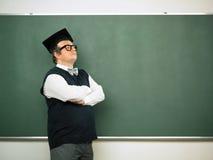 Manlig nerd med korsade armar Fotografering för Bildbyråer