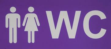 Manlig och kvinnlig WC-symbol som betecknar toaletten Top beskådar Arkivfoton