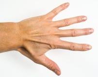 Manlig person som visar fem fingrar Arkivbilder