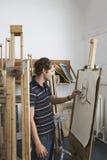 Manlig student Drawing Charcoal Portrait Fotografering för Bildbyråer