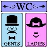 Manliga och kvinnliga toalettsymbolsymboler Arkivfoto
