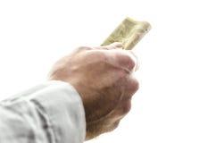 Manlign räcker att ge pengar Arkivbilder