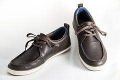 Manlign skor isolerat på vitbakgrund royaltyfri bild