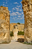 Manlike statue in Lithica quarry, Minorca, Spain Stock Images