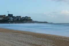 Manly Beach with milky long exposure water looking across to Que Stock Image