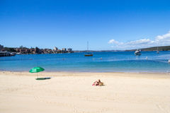 Sunbathing on the beach at Manly Cove, Sydney, Australia Stock Images