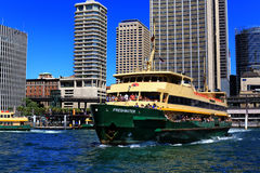 Manly ferry leaving Circular Quay, Sydney. SYDNEY,AUSTRALIA - MARCH 9 2014: One of the famous Manly ferries leaves Circular Quay bound for Manly with a full Stock Image