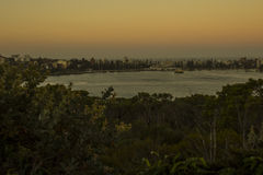 Manly harbour. A moody sunset landscape of manly wharf Stock Photos