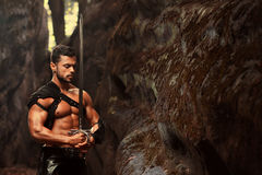 Manly warrior at the mountains Stock Images